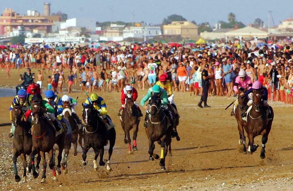 Carrera de caballos en la playa de Sanlúcar de Barrameda